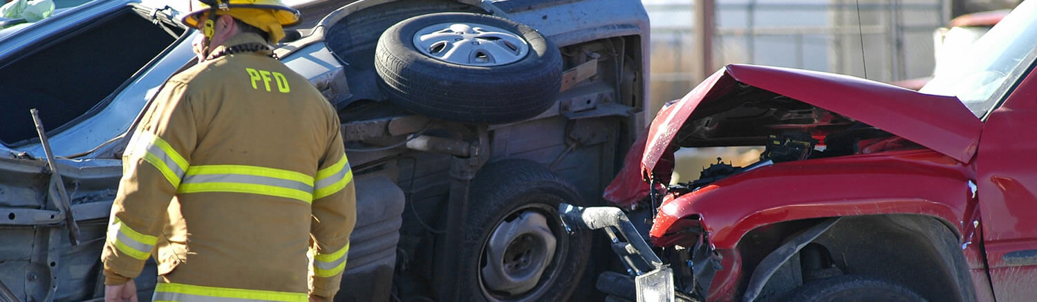Fire Department First Responder Scans The Scene Of A Severe Injury Car Accident